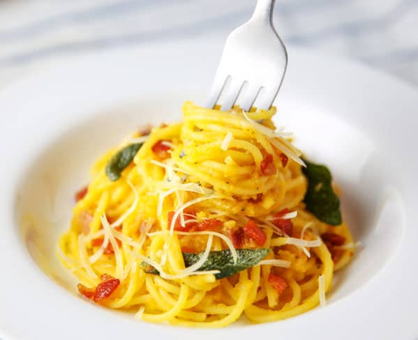 This Butternut Squash Spaghetti with Fried Sage and Pancetta is so easy to make. Using a homemade Butternut Squash pasta sauce, tossed with the Spaghetti, Fried Sage and Pancetta... Wow, so savory!