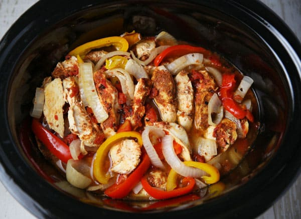 These Slow Cooker Chicken Fajitas are so easy to make and loaded with flavor! Perfect for those busy weeknights!