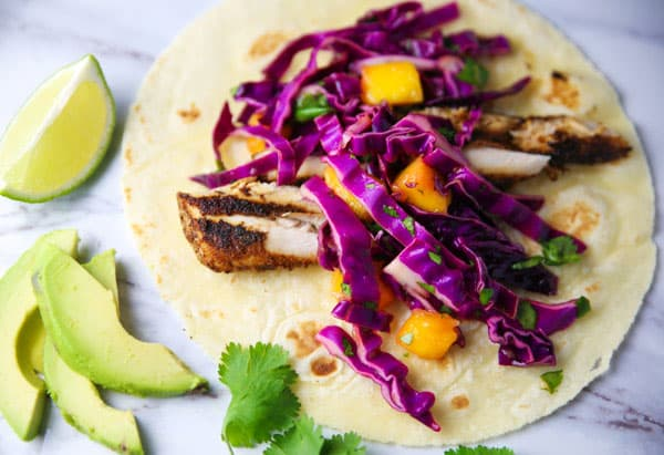 These Blackened Mahi Mahi Tacos with Mango Slaw will be your new favorite fish taco! The spiciness of the fish combined with the sweetness of the slaw are the perfect combo!