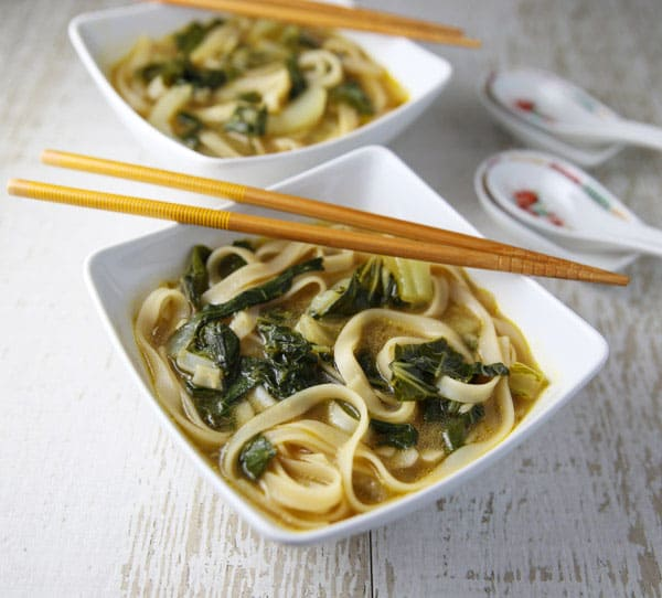 This Ginger Bok Choy Soup with Noodles is incredibly delicious and only takes about 15 minutes to make! #glutenfree #Asianfood #vegetarian #soup #bokchoy #easyrecipes #dutchoven
