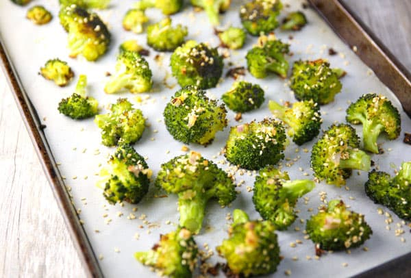 This Ginger Sesame Roasted Broccoli is slightly crispy, tender, and full of flavor! This is the perfect pairing to any Asian dish!