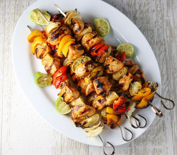 These Grilled Chili Lime Chicken Kabobs are easy to make and oh so savory! This will be truly a crowd favorite at your next bbq! #bbq #grilled #grilledchicken #chicken #kabobs #healthyrecipes #glutenfree
