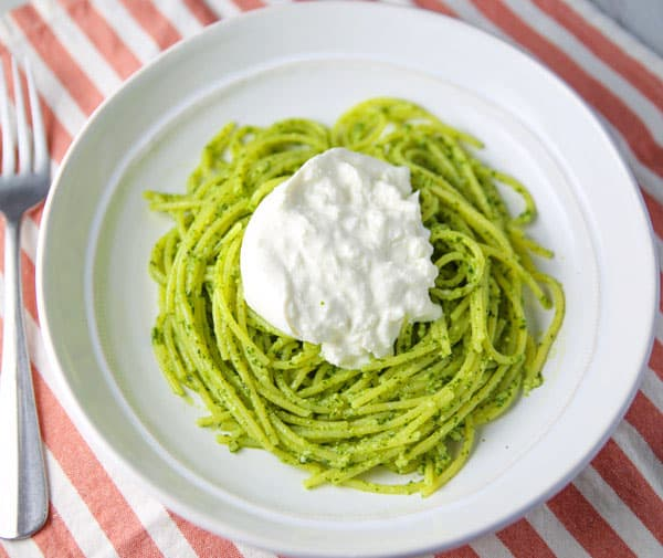 This Lemon Basil Pesto Spaghetti with Burrata comes together in about 10 minutes. So light, fresh, and creamy, this will be your new favorite summer pasta dish!