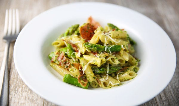 This Lemon Pesto Penne with Crispy Prosciutto and Asparagus comes together in about 20 minutes and is INCREDIBLY delicious! This could be the perfect Spring Time pasta!