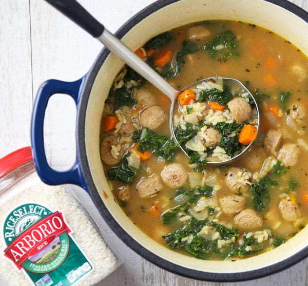 This Sausage and Kale Soup with Arborio Rice can be made in less than 30 minutes and is incredibly savory! This will be your new favorite soup! @Walmart and @RiceSelect #ad #UnforgettableRice #soup #dinner