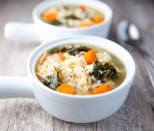 This Slow Cooker Lemon Chicken and Rice Soup with Kale is so healthy, hearty, and savory! This will be your new favorite soup!