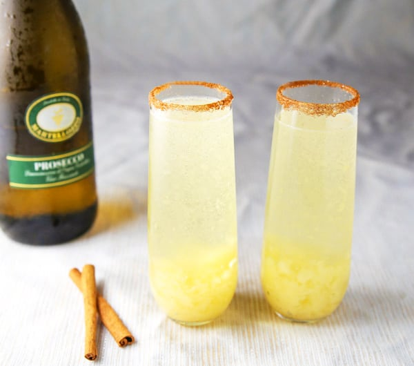 This Spiced Pear Bellini is so light, refreshing, and festive! This is a super easy cocktail to make and is so versatile. You could have this for Brunch, with Appetizers, or even Dessert! #bellini #prosecco #cocktails #cocktail #entertaining #brunch #drinks