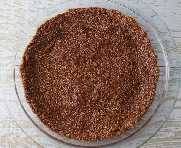 This Chocolate Avocado Pie with a Cashew Crust is so creamy and delicious! You honestly can't even taste the Avocado, it tastes so incredibly chocolaty! #glutenfree #dessert #chocolate #avocado #pie #vegetarian