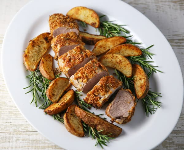 This Rosemary Parmesan Panko Crusted Pork Tenderloin is so tender, juicy and flavorful! Make this tonight and you can have a delicious dinner on the table in 30 minutes! #30minutemeals #dinner #pork #porktenderloin #glutenfree