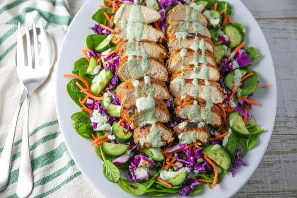 This Grilled Chili Lime Chicken Salad is so incredibly delicious! We used a super simple marinade for the chicken, which comes out perfectly tender and juicy once grilled! #grilling #grill #grilled #chicken #salad #glutenfree