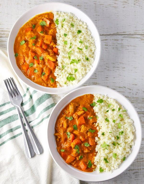 This Spicy Chicken Curry with Cauliflower Rice comes together in about 30 minutes and is loaded with flavor! #lowcarb #glutenfree #chicken #curry #cauliflowerrice #dinner