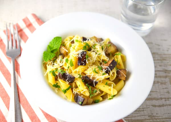 This Penne with Eggplant and Mint can be made in about 10 minutes and is bursting with so much flavor! #glutenfree #pasta #Italianfood #vegetarian