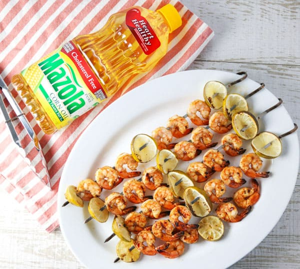 ad - Today I put together an easy peasy grilling recipe for these Grilled Chili Lime Shrimp Kabobs! This is a super easy recipe that everyone is sure to love! #MyMazolaMarinade #shrimp #kabobs #grilled