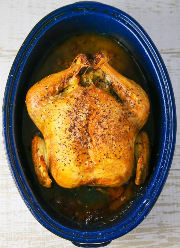 This Roasted Chicken with Lemon and Parsley could be the perfect Sunday dinner. It's so tender and juicy on the inside while the skin on the outside stays nice and crispy. #roastedchicken #chicken #wholechicken #glutenfree #dinner