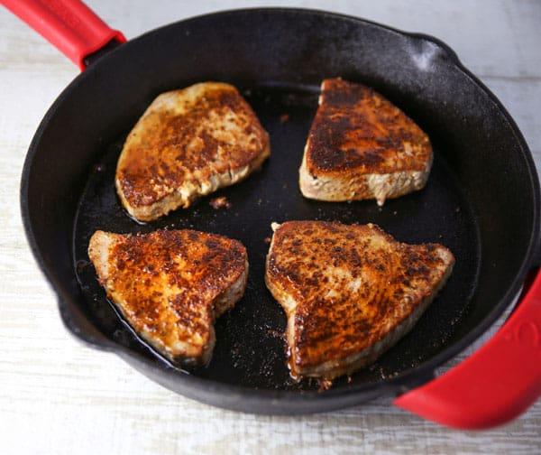 Blackened Tuna Steaks in a skillet
