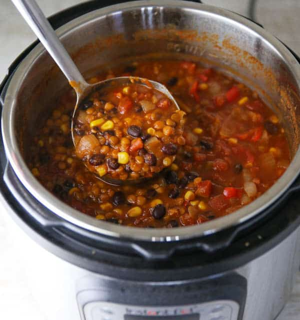 Lentil and Black Bean Chili being scooped out in the Instant Pot