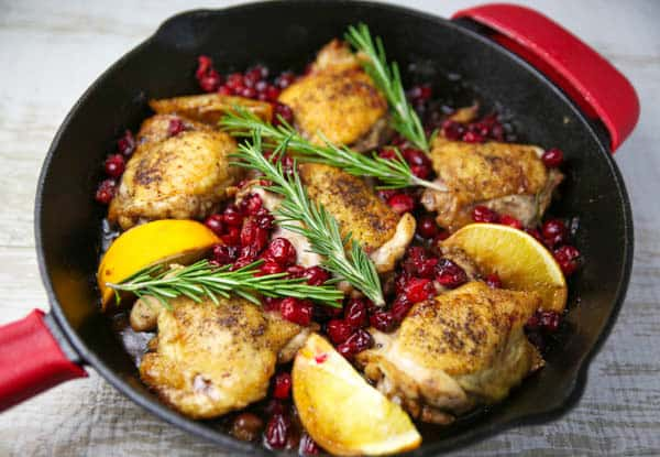 Cranberry Orange Chicken Thighs with Rosemary in skillet