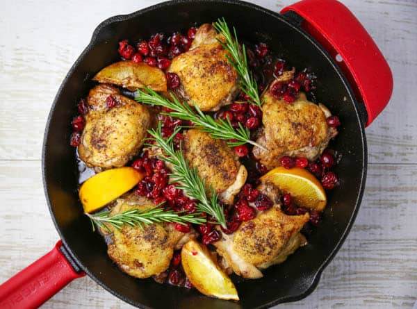 Cranberry Orange Chicken Thighs with Rosemary in a skillet