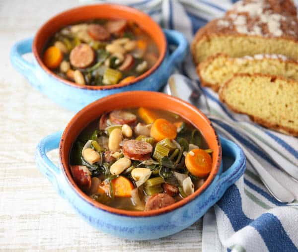 Spicy Sausage and White Bean Soup with Spinach with bread