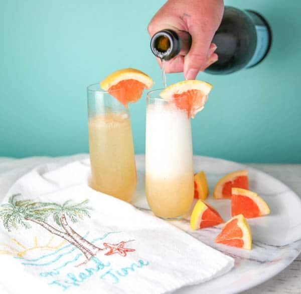 Grapefruit Mimosas being made