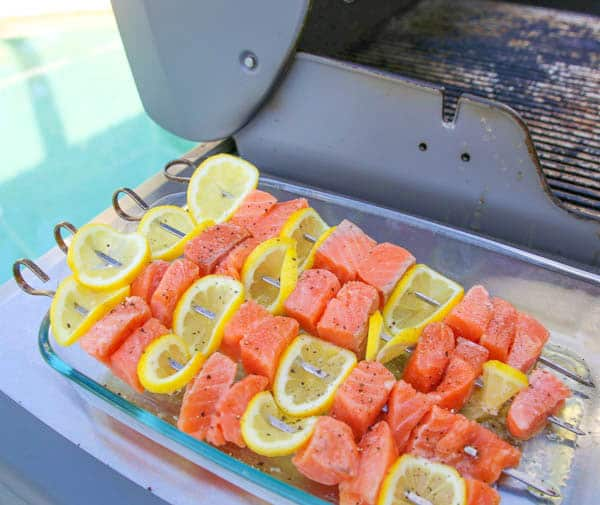 Lemon Salmon Skewers next to the grill
