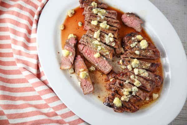 New York Strip Steaks sliced on a platter