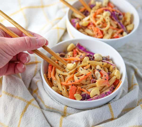 Digging chopsticks in a Pad Thai Noodle Bowl