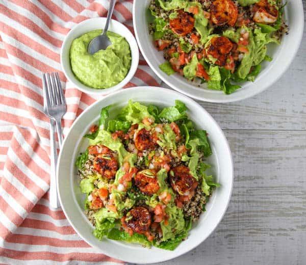Blackened Shrimp Quinoa Salad with Avocado Cilantro Dressing in 2 bowls