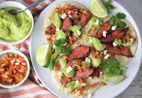 Blackened Flank Steak Tacos with Avocado Lime Sauce