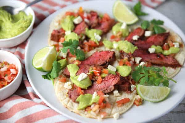 Blackened Flank Steak Tacos with Avocado Lime Sauce on a plate