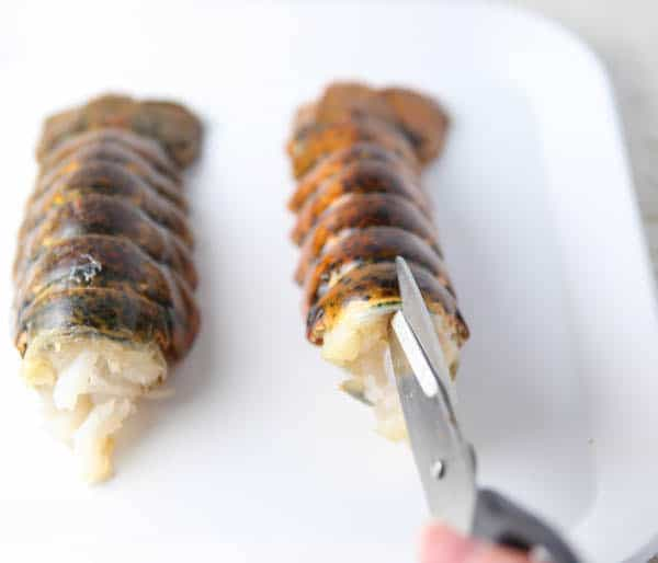 Cutting the shell of the lobster tail