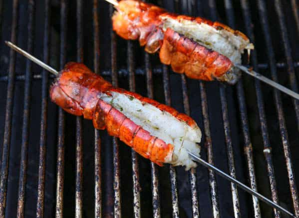 Skewered lobster tails on the grill
