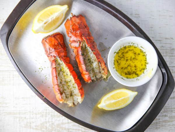 Cooked lobster tails on a platter